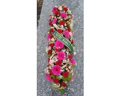 composition florale deuil dessus de cercueil fuchsia rouge