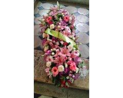 composition florale deuil raquette pastel